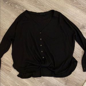 Black sweater with tie at the bottom